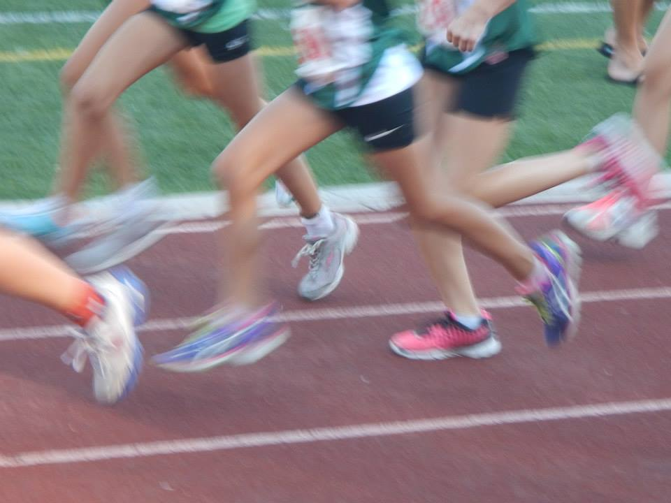 kids running on a track